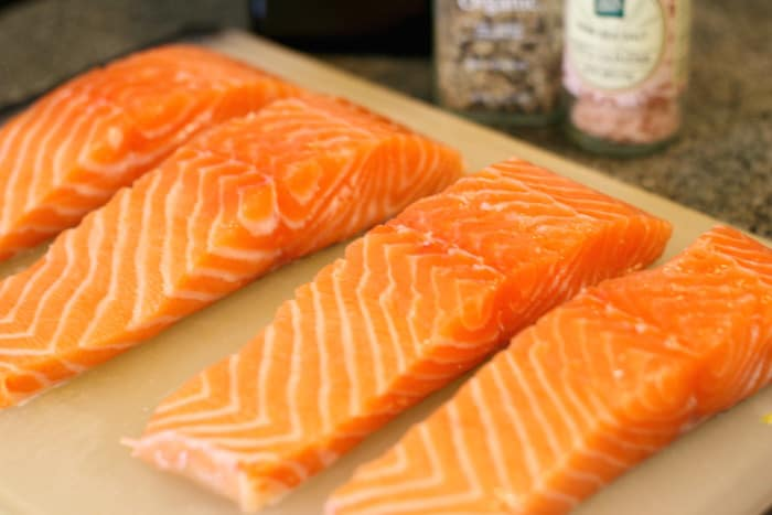 preparing to cook salmon fillets in pan