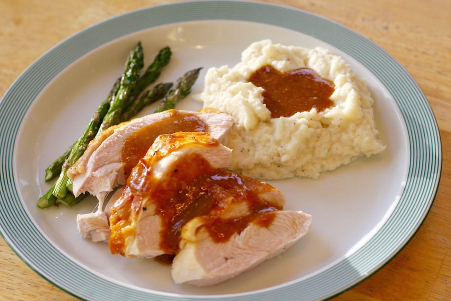 roasted turkey breast served with asparagus and mashed cauliflower
