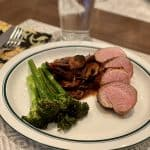 oven roasted broccolini served with pork tenderloin