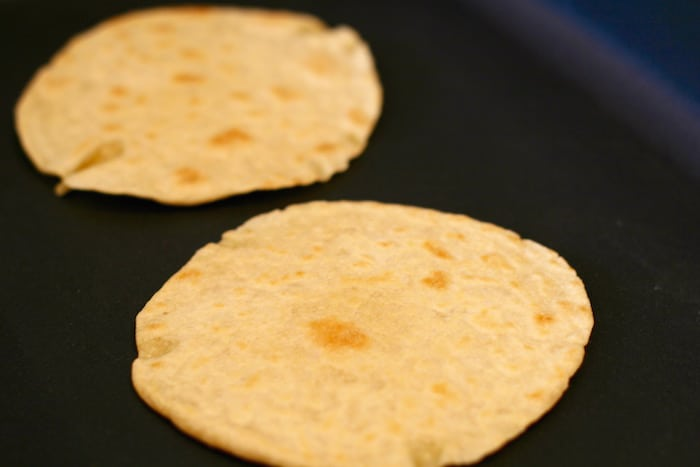 homemade Einkorn wheat flour tortillas getting browned in a pan