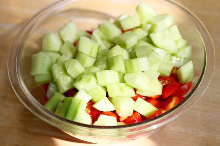 preparing tomato and cucumber salad