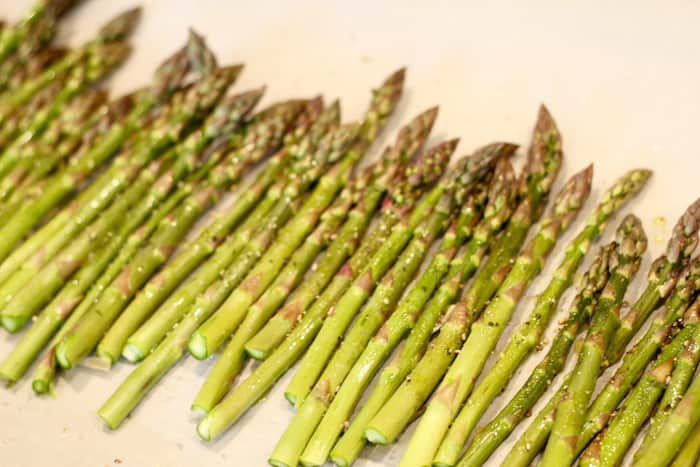 getting ready for roasting asparagus in the oven