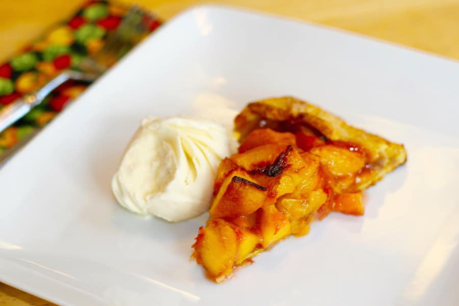 fresh peach galette with vanilla ice cream