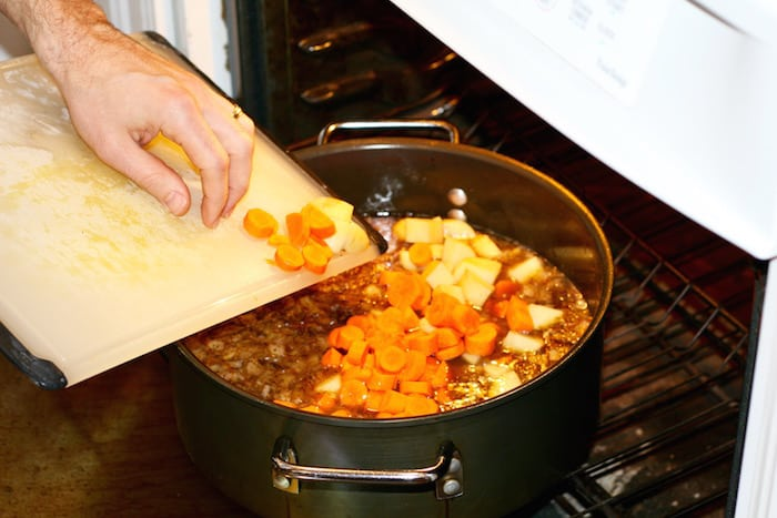 adding carrots and potatoes to beef stew