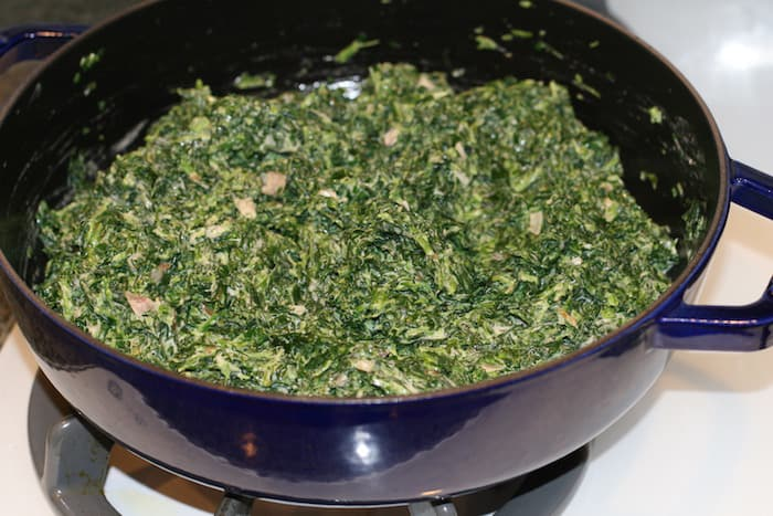 adding the spinach to my creamed spinach dish