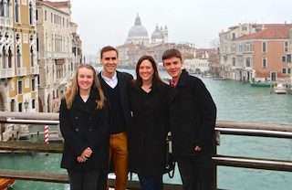 Greg and his family traveling abroad in Venice