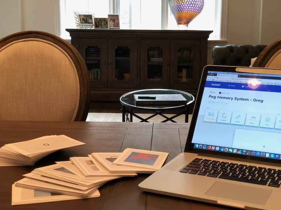 dining room table shown with memory system flashcards and computer screen