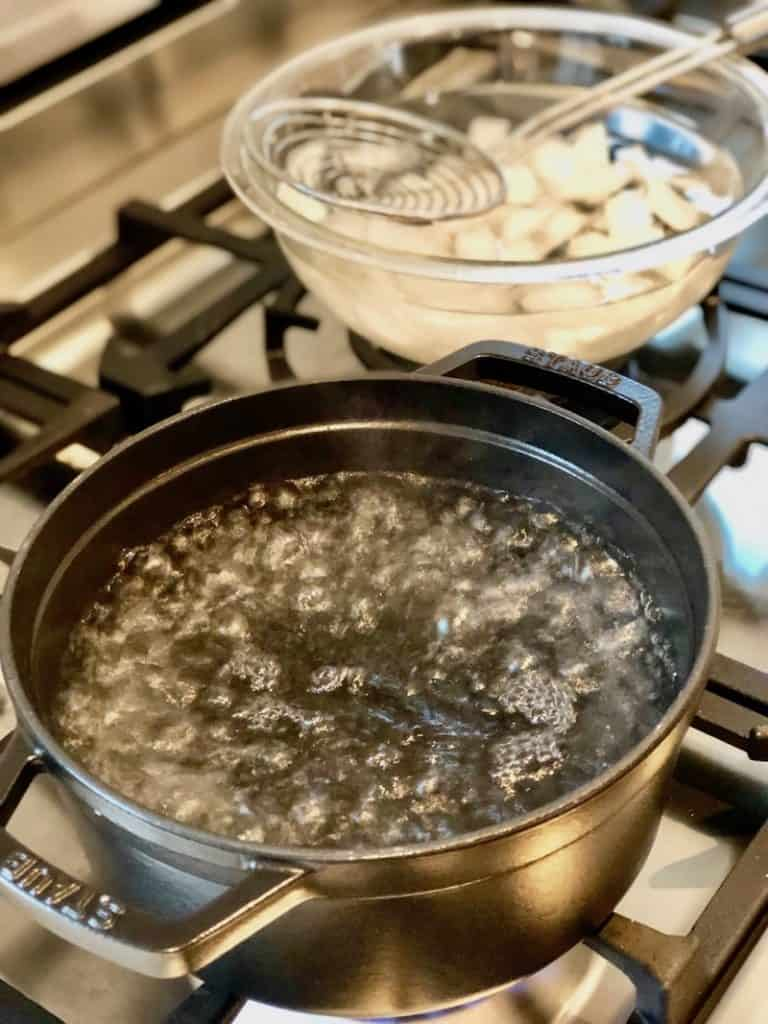your boiled eggs will peel better if you start with boiling water like this pot and then drop your eggs into an ice bath after cooking