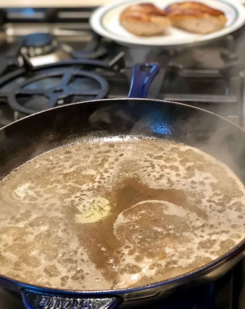 making pan sauce on stove for chicken dinner