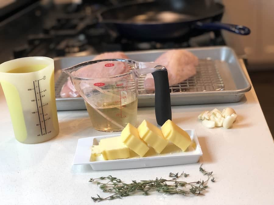 preparing ingredients to cook with chicken breasts