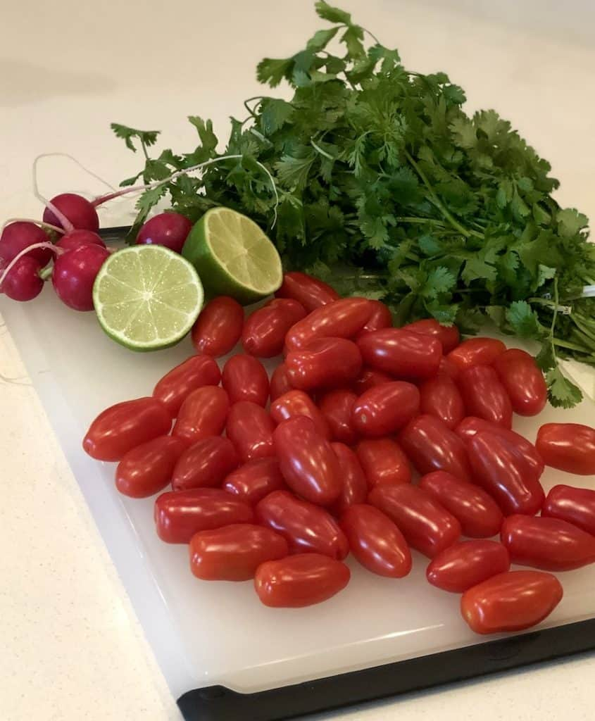 prepping ingredients for tomato and cilantro salad