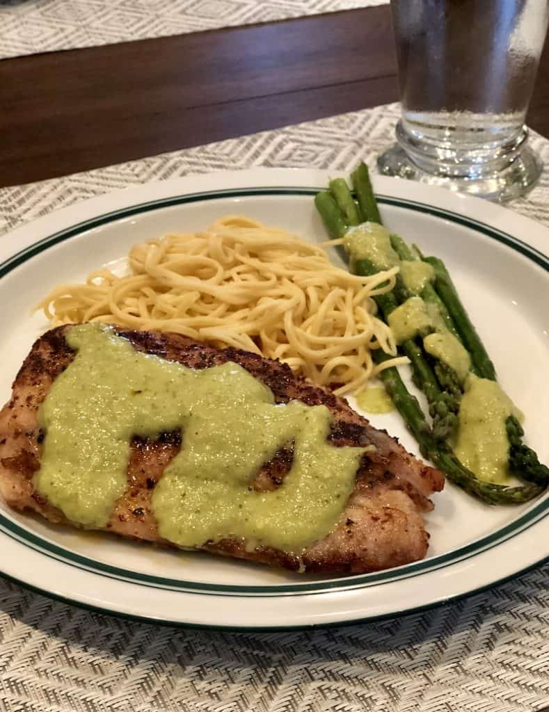 tomatillo sauce served over blackened fish