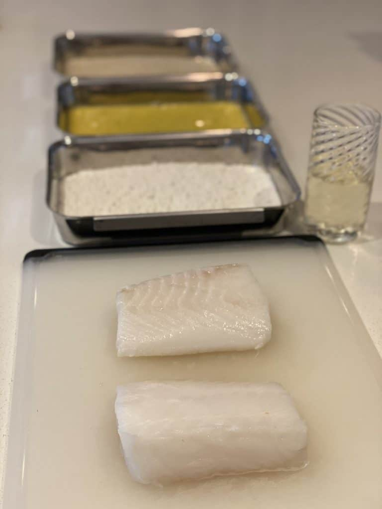 getting ready to bread sea bass fillets