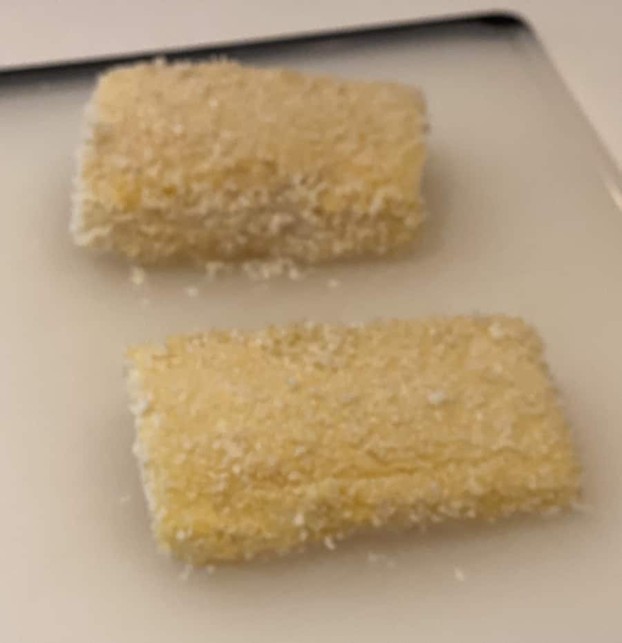 sea bass fillets after breading