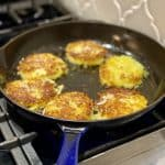 frying potato latkes in a pan